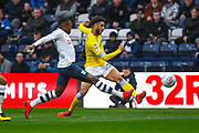 Tyler Roberts of Leeds United (11) shoots during the EFL Sky Bet Championship match between Preston North End and Leeds United at Deepdale, Preston, England on 9 April 2019.