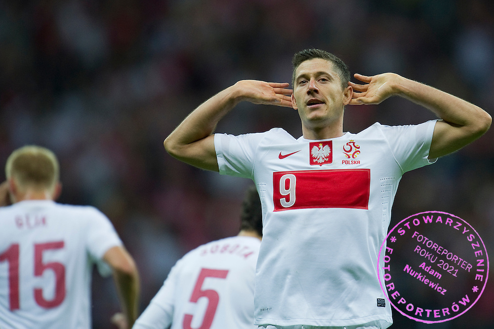 Poland's Robert Lewandowski celebrates after scoring during the 2014 World Cup Qualifying Group H football match between Poland and Montenegro at National Stadium in Warsaw on September 06, 2013.<br /> <br /> Poland, Warsaw, September 06, 2013<br /> <br /> Picture also available in RAW (NEF) or TIFF format on special request.<br /> <br /> For editorial use only. Any commercial or promotional use requires permission.<br /> <br /> Mandatory credit:<br /> Photo by &copy; Adam Nurkiewicz / Mediasport