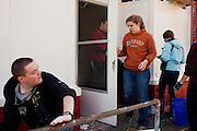 Boston College students spend their spring break volunteering with Habitat for Humanity and other community-based outreach organizations in Cheritan, Virginia on Tuesday, March 6, 2012.