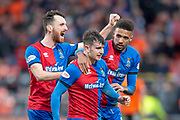 Aaron Doran (#10) of Inverness Caledonian Thistle FC is congratulated by Nathan Austin (#9) and Joe Chalmers (#4)  after he scores the winning goal during the William Hill Scottish Cup quarter final match between Dundee United and Inverness CT at Tannadice Park, Dundee, Scotland on 3 March 2019.