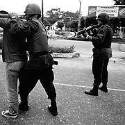 A police patrol  searches a  man at gunpoint for ID and weapons in Saravena, Aruaca, Colombia. Two rebel groups; the ELN and FARC as well as the rightwing AUC are all fighting for control of this oil rich region.<br />