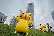 Pikachu statues in  small park in frotnt of Landmark Tower during the third annual Pikachu Outbreak event in Yokohama, Kanagawa, Japan. Wednesday August 10th 2016. The event is hosted by the Pokemon Company. Over 1,000 Pikachu characters are set to appear in week of events from 7th to 14th of August..