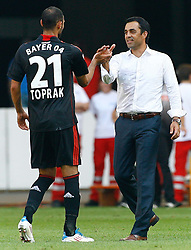 20.08.2011, Mercedes-Benz Arena, Stuttgart, GER, 1.FBL, VfB Stuttgart vs Bayer Leverkusen, Abpfiff, Oemer TOPRAK, Bayer Leverkusen und Robin DUTT, Trainer Bayer Leverkusen..// during the match from GER, 1.FBL, VfB Stuttgart vs Bayer Leverkusen on 2011/08/20,  Mercedes-Benz Arena, Stuttgart, Germany..EXPA Pictures © 2011, PhotoCredit: EXPA/ nph/  A.Huber       ****** out of GER / CRO  / BEL ******
