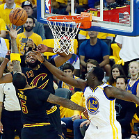 12 June 2017: Cleveland Cavaliers guard JR Smith (5) goes for the layup past Golden State Warriors forward Draymond Green (23) during the Golden State Warriors 129-120 victory over the Cleveland Cavaliers, in game 5 of the 2017 NBA Finals, at the Oracle Arena, Oakland, California, USA.