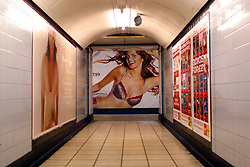 UK ENGLAND LONDON 29NOV02 - A slim model in a bra advertises on a billboard at Oxford Circus Station, London Underground. ..The London Underground is a rapid transit system serving a large part of Greater London and neighbouring areas of Essex, Hertfordshire and Buckinghamshire in the UK. The Underground has 270 stations and about 400 km of track, making it the longest metro system in the world by route length; it also has one of the highest number of stations and transports over three million passengers daily...jre/Photo by Jiri Rezac..© Jiri Rezac 2002