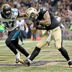 Dec 27, 2015; New Orleans, LA, USA; New Orleans Saints tight end Michael Hoomanawanui (84) catches a touchdown past Jacksonville Jaguars strong safety Johnathan Cyprien (37) during the first quarter of a game at the Mercedes-Benz Superdome. Mandatory Credit: Derick E. Hingle-USA TODAY Sports