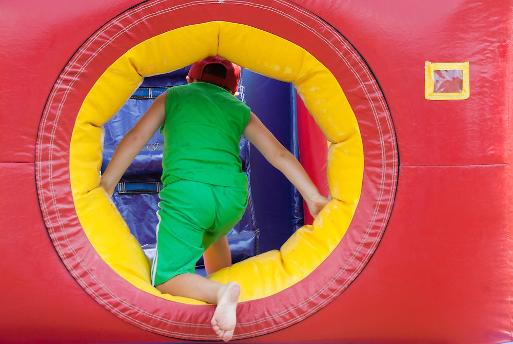 Child in blow-up jungle gym
