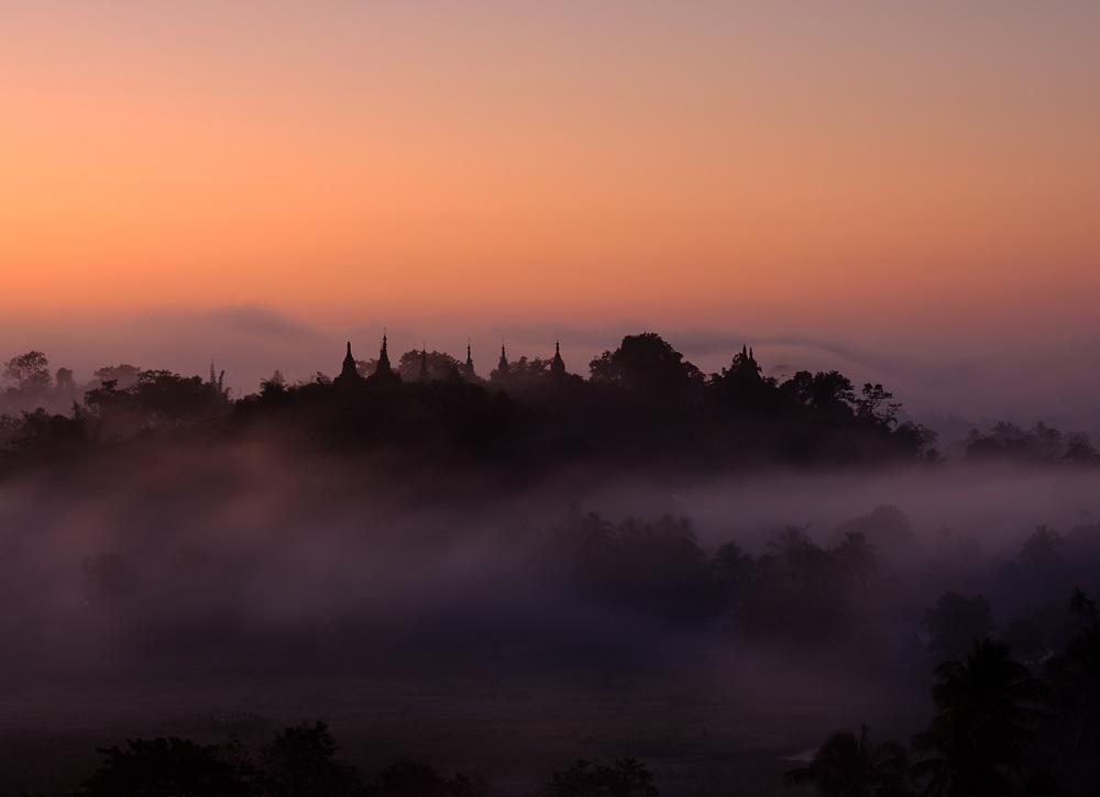 MRAUK U, MYANMAR - CIRCA DECEMBER 2017: Sunrise over the hills of Mrauk U in Myanmar