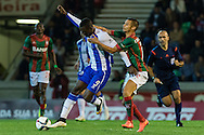 Portugal, FUNCHAL : Porto's Colombian forward Jackson Martinez (L)  vies with Maritimo's Portuguese forward Edgar Costa (R ) during Portuguese League football match Maritimo vs F.C. Porto at Barreiros Stadium in Funchal on January  25, 2015. PHOTO/ GREGORIO CUNHA