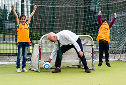 Pictured: Joe FitzPartrick joined in with youngsters to get some exercise<br /> <br /> Public Health and Sport Minister Joe FitzPatrick visited the St Augustine's School and Forester School share campus in Edinburgh today to  launch the Active Scotland Delivery programme, which aims to reduce physical inactivity in adults and teenagers in Scotland by 15% by 2030. <br /> <br /> Ger Harley; Edinburgh Elite media