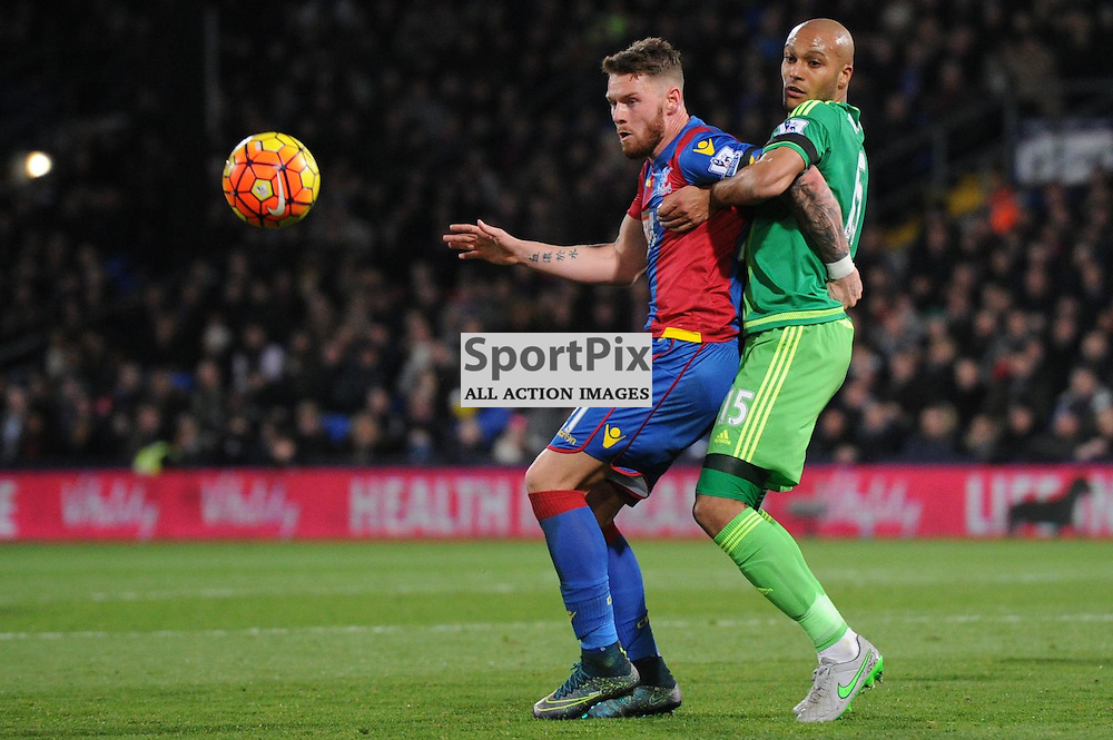 Crystal Palaces Connor Wickham and Sunderlands Younes Kaboul in action during Crystal Palaces clash with Sunderland in the Barclays Premier League at Selhurst Park