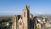Aerial view of the Cathedral Saint-Samson, begun in the 13th century on the site of an older church and completed in the 18th century, in Dol-de-Bretagne, Brittany, France. The cathedral is dedicated to one of the founding saints of Brittany and until 1801 was the seat of the archbishopric of Dol. The North tower was built in the 16th century and never completed, the South tower was built 13th - 17th centuries. Picture by Manuel Cohen