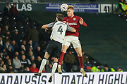 Northampton Town midfielder Ryan Watson heads the ball during the The FA Cup match between Derby County and Northampton Town at the Pride Park, Derby, England on 4 February 2020.