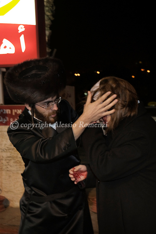 .JERUSALEM : An injured Orthodox Jewish woman is protected by her husband after she was hit on the face by a stone thrown by a Palestinian boy after clashes between Palestinians and Israeli settlers in Jerusalem's Sheikh Jarrah neighbourhood on December 11, 2009. Twenty-one activists protesting in solidarity with evicted Palestinian families were detained during a demonstration in Jerusalem, police said..© ALESSIO ROMENZI