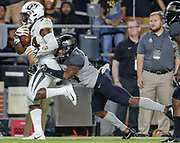 WEST LAFAYETTE, IN - SEPTEMBER 15: Larry Rountree III #34 of the Missouri Tigers runs the ball as Antonio Blackmon #14 of the Purdue Boilermakers tries to make the tackle from behind at Ross-Ade Stadium on September 15, 2018 in West Lafayette, Indiana. (Photo by Michael Hickey/Getty Images) *** Local Caption *** Larry Rountree; Antonio Blackmon NCAA Football - Purdue Boilermakers vs Missouri Tigers at Ross-Ade Stadium in West Lafayette, Indiana. Sports photographer by Michael Hickey