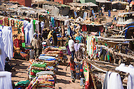 The fabric market in Mopti's harbour. At the confluence of the Niger and the Bani rivers, between Timbuktu and Ségou, Mopti is the second largest city in Mali, and the hub for commerce and tourism in this west-african landlocked country.