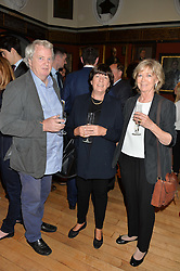 Left to right, ROBERT KIME, GISELLA MILNE-WATSON and LIZ ELLIOT at a party to celebrate the publication of English Houses by Ben Pentreath held at the Art Worker's Guild, 6 Queen Square, London on 28th September 2016.