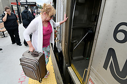 Betsy Simon, of Straford, NJ, boards the train to Atlantic City on the Atlantic City Rail Line platform, in Lindenwold, NJ, on August 20, 2018. The scheduled installation of PCT will temporary interrupt ACRL service till the end of December.