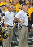 October 6 2013: Iowa Hawkeyes head coach Kirk Ferentz and his son, Offensive Line coach Brian Ferentz, stand before the start of the NCAA football game between the Michigan State Spartans and the Iowa Hawkeyes at Kinnick Stadium in Iowa City, Iowa on October 6, 2013. Michigan State defeated Iowa 26-14.