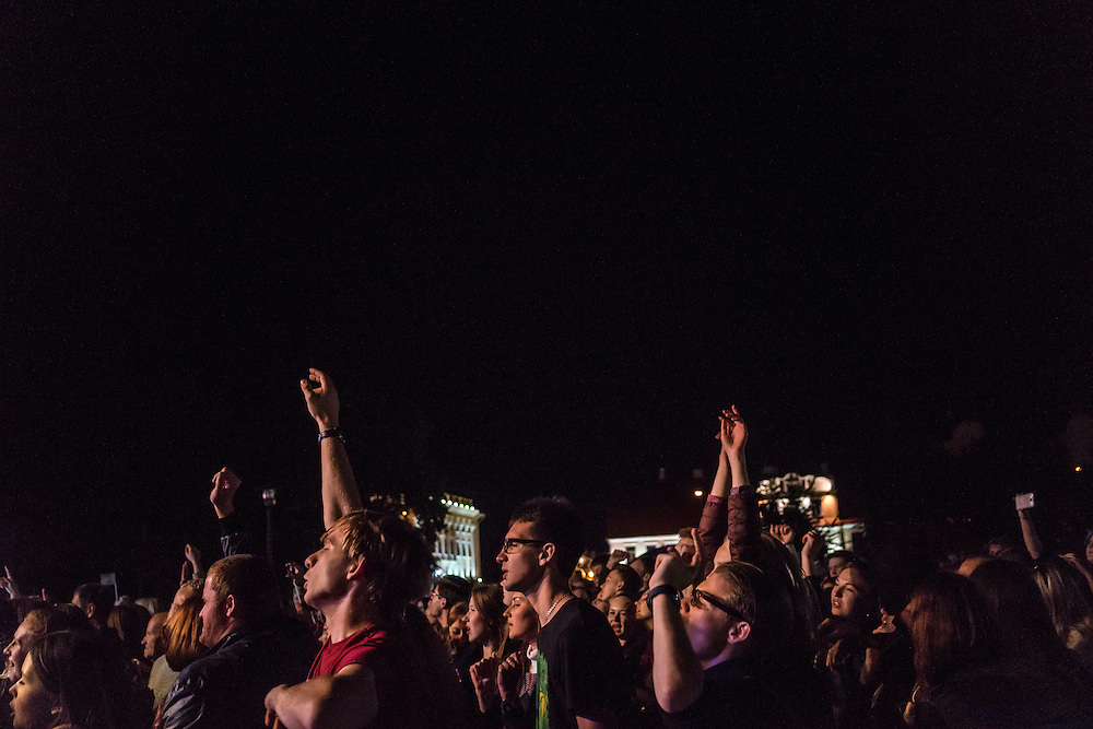 People watch a band perform during a festival on Saturday, September 17, 2016 in Grodno, Belarus.