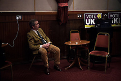 "© London News Pictures. ""Looking for Nigel"". A body of work by photographer Mary Turner, studying UKIP leader Nigel Farage and his followers throughout the 2015 election campaign. PICTURE SHOWS - Nigel Farage listens to speakers during a public meeting in Margate's Winter Gardens, before going on stage himself, during UKIP's 'Action Weekend' in his constituency of South Thanet, on April 11th 2015. Members of UKIP's youth branch 'Young Independence' came from all over the country to help canvas and distribute UKIP campaign materials during the weekend. . Photo credit: Mary Turner/LNP **PLEASE CALL TO ARRANGE FEE** **More images available on request**"