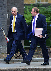 © Licensed to London News Pictures. 18/09/2012. Westinster, UK LEFT: Business Secretary Vince Cable and Energy and Climate Secretary Ed Davey. Cabinet meeting today in Downing Street 18 September 2012. Photo credit : Stephen Simpson/LNP
