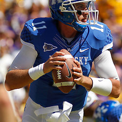 October 1, 2011; Baton Rouge, LA, USA;  Kentucky Wildcats quarterback Maxwell Smith (11) against the LSU Tigers during the fourth quarter at Tiger Stadium. LSU defeated Kentucky 35-7. Mandatory Credit: Derick E. Hingle-US PRESSWIRE / © Derick E. Hingle 2011