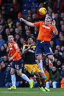 Steve McNulty of Luton Town (right) clearts the ball under pressure from Sean Jeffers of Newport County (centre) as Michael Harriman of Luton Town (left) looks on during the Sky Bet League 2 match at Kenilworth Road, Luton<br /> Picture by David Horn/Focus Images Ltd +44 7545 970036<br /> 20/12/2014