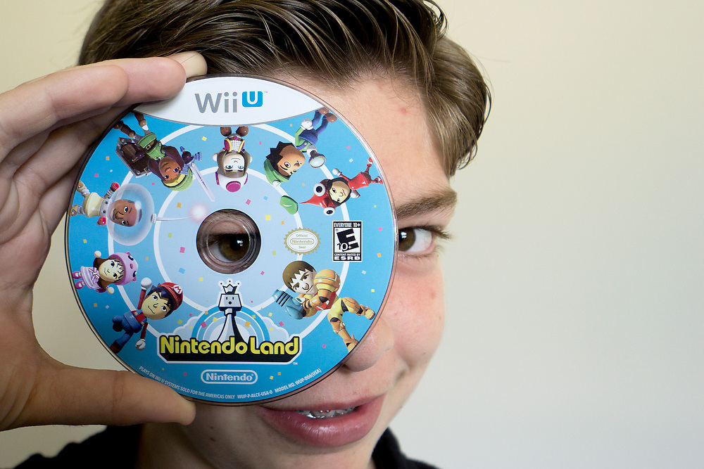 MAY 23, 2015---BOCA RATON, FLORIDA----<br /> Jordan Zietz, 13, poses with some of the vide gameshe rents as part of his business GAMEREEF. Jordan and his sister are rolling in their father's entrepreneurial vein and have successful businesses.