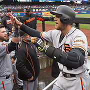 NEW YORK, NEW YORK - MAY 01: Hunter Pence #8 of the San Francisco Giants is congratulated by team mates as he returns to the dugout after hitting a home run during the New York Mets Vs San Francisco Giants MLB regular season game at Citi Field on May 01, 2016 in New York City. (Photo by Tim Clayton/Corbis via Getty Images)