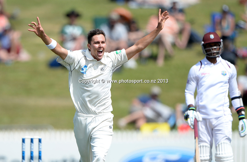 Trent Boult celebrates the wicket of Kirk Edwards on Day 3 of the 3rd cricket test match of the ANZ Test Series. New Zealand Black Caps v West Indies at Seddon Park in Hamilton. Saturday 21 December 2013. Photo: Andrew Cornaga / www.Photosport.co.nz