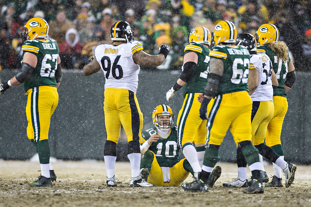 GREEN BAY, WI - DECEMBER 22:  Matt Flynn #10 of the Green Bay Packers is helped up off the ground during a game against the Pittsburgh Steelers at Lambeau Field on December 22, 2013 in Green Bay, Wisconsin.  The Steelers defeated the Packers 38-31.  (Photo by Wesley Hitt/Getty Images) *** Local Caption *** Matt Flynn