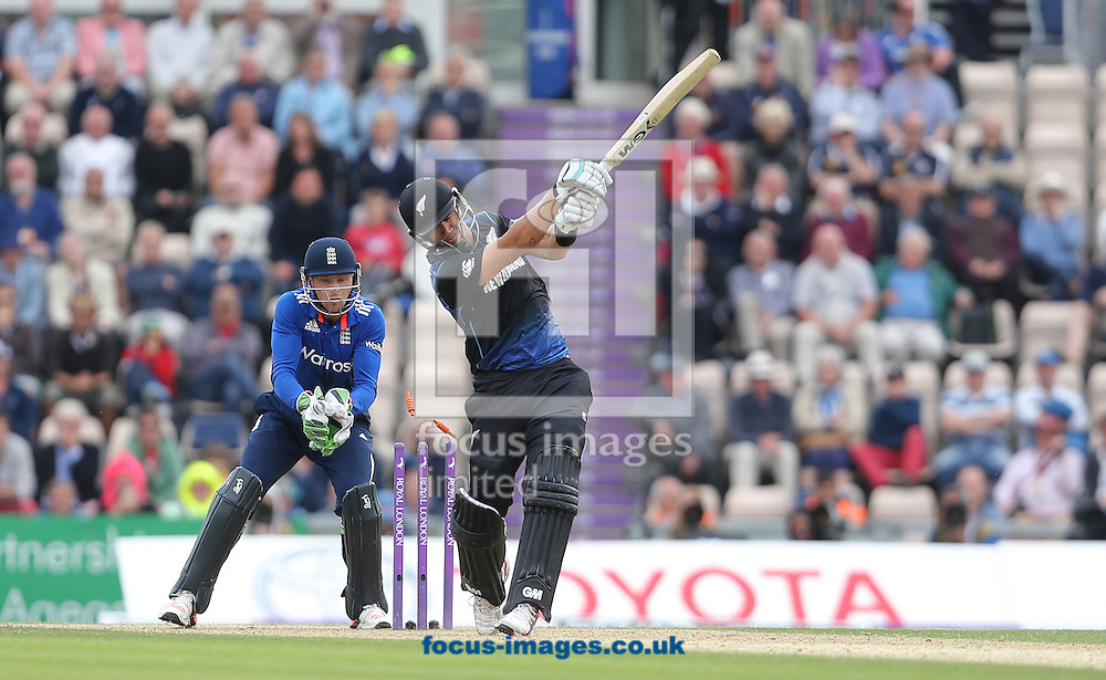 Jos Butler ( L ) of England watches on as Ross Taylor of New Zealand is bowled out by David Willey ( not pictured ) during the Royal London One Day Series match at the Ageas Bowl, West End<br /> Picture by Paul Terry/Focus Images Ltd +44 7545 642257<br /> 14/06/2015