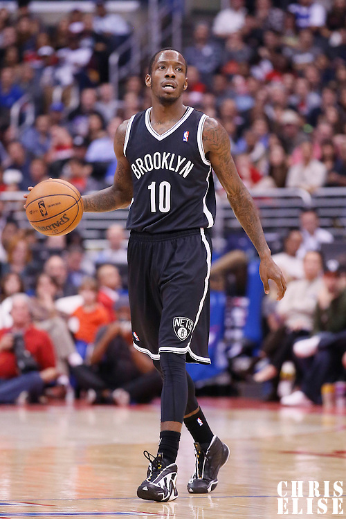 16 November 2013: Brooklyn Nets Tyshawn Taylor brings the ball upcourt during the Los Angeles Clippers 110-103 victory over the Brooklyn Nets at the Staples Center, Los Angeles, California, USA.