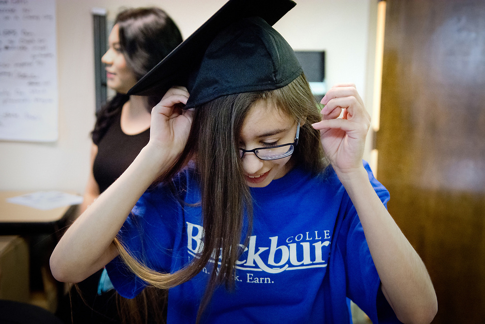 mkb0506173/metro/Marla Brose --  Health Leadership High School senior Carolyn Baca, who plans to become a cardiothoracic surgeon, tries on her graduation cap after she was awarded with the Hope Scholarship, a full-ride scholarship to Blackburn College in Carlinville, Illinois, Tuesday, May 9, 2017. Baca photographed the exterior of the University of New Mexico Hospital to express her hopes and dreams for the Pictures of Hope photo exhibition at her Albuquerque school. (Marla Brose/Albuquerque Journal)