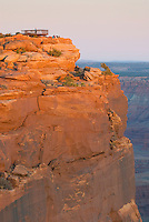 Sandstone cliff glowing red in the setting sun, Dead Horse Point State Park Utah