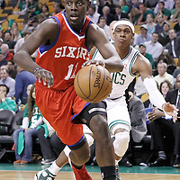 14 May 2012: Philadelphia Sixers point guard Jrue Holiday (11) drives past Boston Celtics point guard Rajon Rondo (9) during the Philadelphia Sixers 82-81 victory over the Boston Celtics, in Game 2 of the Eastern Conference semifinals playoff series, at the TD Banknorth Garden, Boston, Massachusetts, USA.