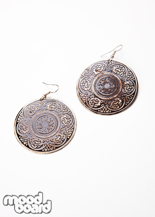 Beautiful design on earrings over white background