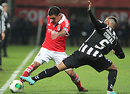 Portugal, FUNCHAL : Benfica's Uruguayan defender Maxi Pereira (L )  vies with Nacional´s Brazilian defender Marçal (r) during Portuguese League football match Nacional vs Benfica at Madeira Stadium in Funchal on February 10, 2013. PHOTO/ GREGORIO CUNHA..