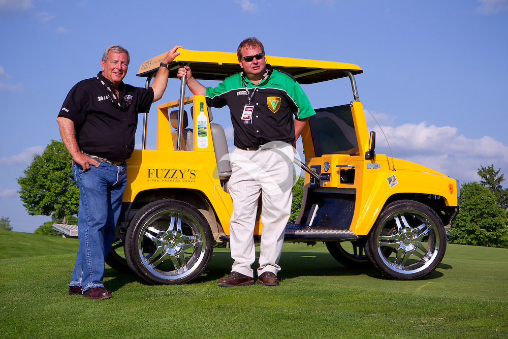 Fuzzy's Vodka owners Fuzzy Zoeller and Stuart Reed pose on the golf course at the Indianapolis Motor Speedway in Indianapolis, Indiana. Photo by Michael Hickey, Infiniti Images.  Client, Fuzzy's Vodka