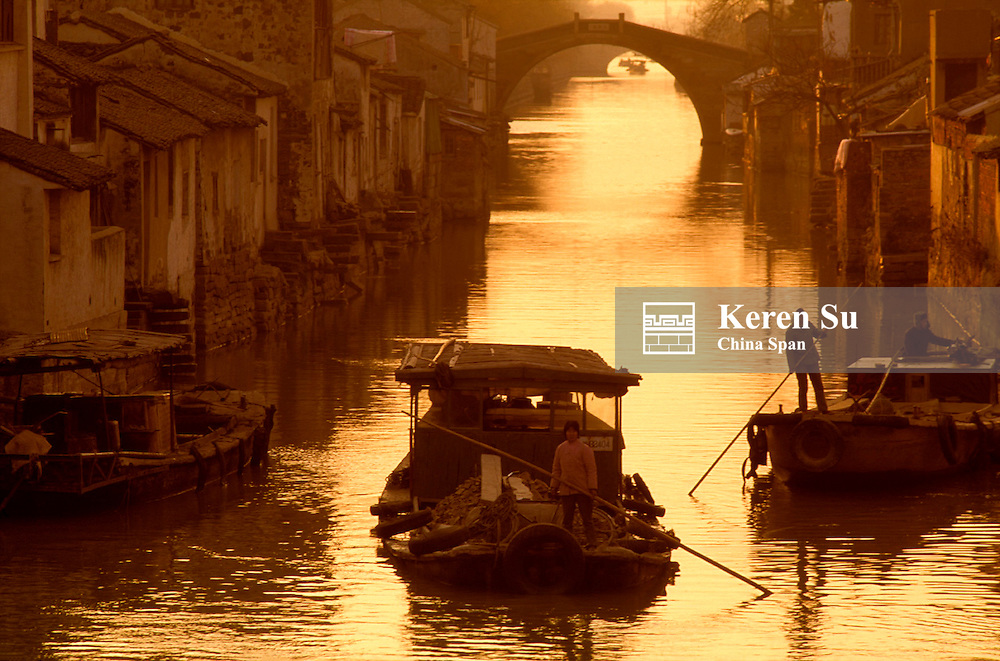 Traditional architecture with stone bridge and boats on the Grand Canal, Suzhou, Jiangsu Province, China