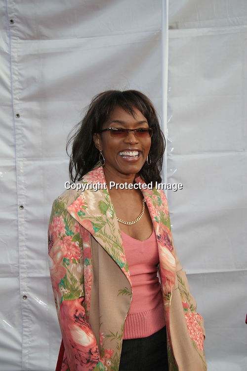 Angela Bassett<br />2004 DREAM HALLOWEEN Fundraiser by The Children Affected by AIDS Foundation [CAAF]<br />Barker Hangar<br />Santa Monica, CA, USA<br />Saturday, October 30th, 2004<br />Photo By Celebrityvibe.com/Photovibe.com, <br />New York, USA, Phone 212 410 5354, <br />email: sales@celebrityvibe.com