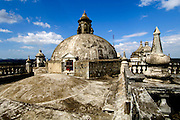 Domes, pinnacles and bannisters are part of the rooftop architecture of the  Cathedral of Leon, Central America's largest cathedral in Leon, Nicaragua.