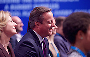 Conservative Party Conference Manchester Great Britain <br /> 5th October 2015 <br /> David Cameron watches and reacts to a joke about Osborne going Corbyn's shadow cabinet <br /> <br /> <br /> George Osborne<br /> First Secretary of State<br /> Chancellor of the Exchequer <br /> keynote speech <br /> <br /> <br /> Photograph by Elliott Franks <br /> Image licensed to Elliott Franks Photography Services
