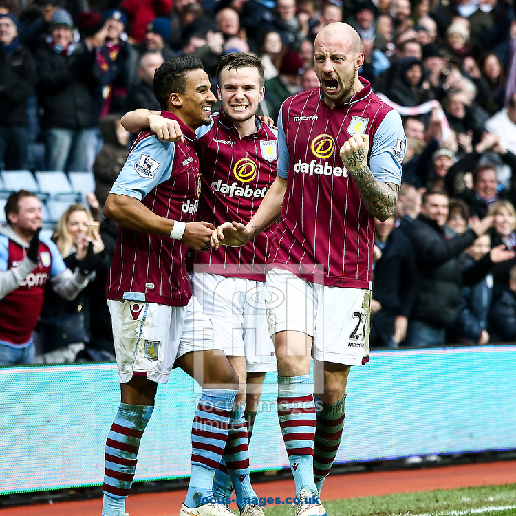 Leandro Bacuna of Aston Villa (left)  celebrates scoring their second goal with Tom Cleverley of Aston Villa (centre) and Alan Hutton of Aston Villa (right) during the FA Cup match at Villa Park, Birmingham<br /> Picture by Andy Kearns/Focus Images Ltd 0781 864 4264<br /> 15/02/2015