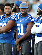 Indianapolis Colts linebacker Sio Moore (51) stands next to teammates while officials announce the cancellation of the 2016 NFL Pro Football Hall of Fame preseason football game against the Green Bay Packers on Sunday, Aug. 7, 2016 in Canton, Ohio. The game was canceled for player safety reasons due to the condition of the paint on the turf field. (©Paul Anthony Spinelli)