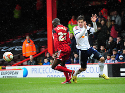 Bristol City's Albert Adomah battles for the ball with Bolton Wanderers' Marcos Alonso - Photo mandatory by-line: Joe Meredith/JMP - Tel: Mobile: 07966 386802 13/04/2013 - SPORT - FOOTBALL - Ashton Gate - Bristol - Bristol City V Bolton Wanderers - Npower Championship