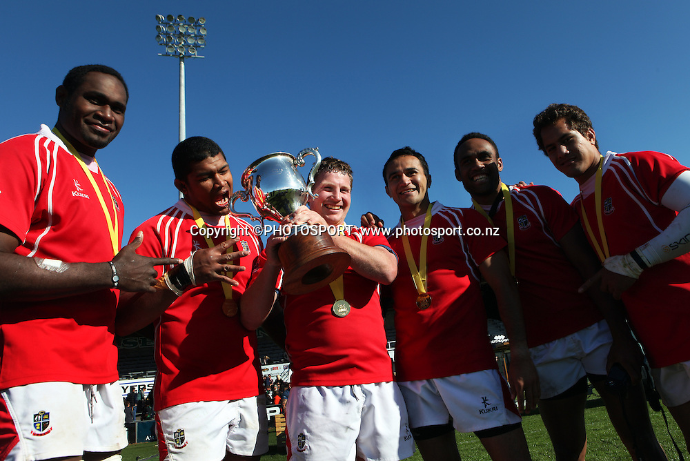 Poverty Bay captain Scott Leighton with a few team mates and the Lochore Cup after their win in the Heartland Championship Lochore Cup Final between, South Canterbury v Poverty Bay at Alpine Energy Stadium, Timaru, South Canterbury. Saturday 8 October 2011. Photo : Joseph Johnson/photosport.co.nz