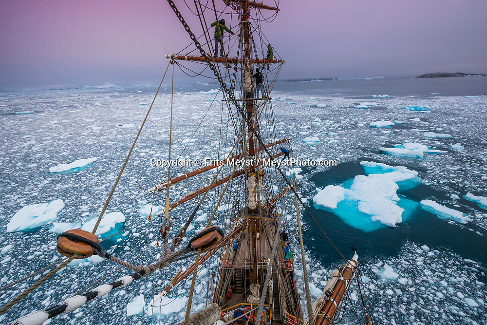 Antarctica, February 2018. Sailors in the rigging at sunset, during the passage through the Bransfield Straight. Dutch Tallship, Bark Europa, explores Antarctica during a 22 day sailing expedition. Photo by Frits Meyst / MeystPhoto.com