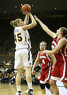 19 February 2009: Iowa forward/center JoAnn Hamlin (45) puts up a shot over Wisconsin guard Alyssa Karel (30) during the first half of an NCAA women's college basketball game Thursday, February 19, 2009, at Carver-Hawkeye Arena in Iowa City, Iowa. Iowa defeated Wisconsin 72-65.